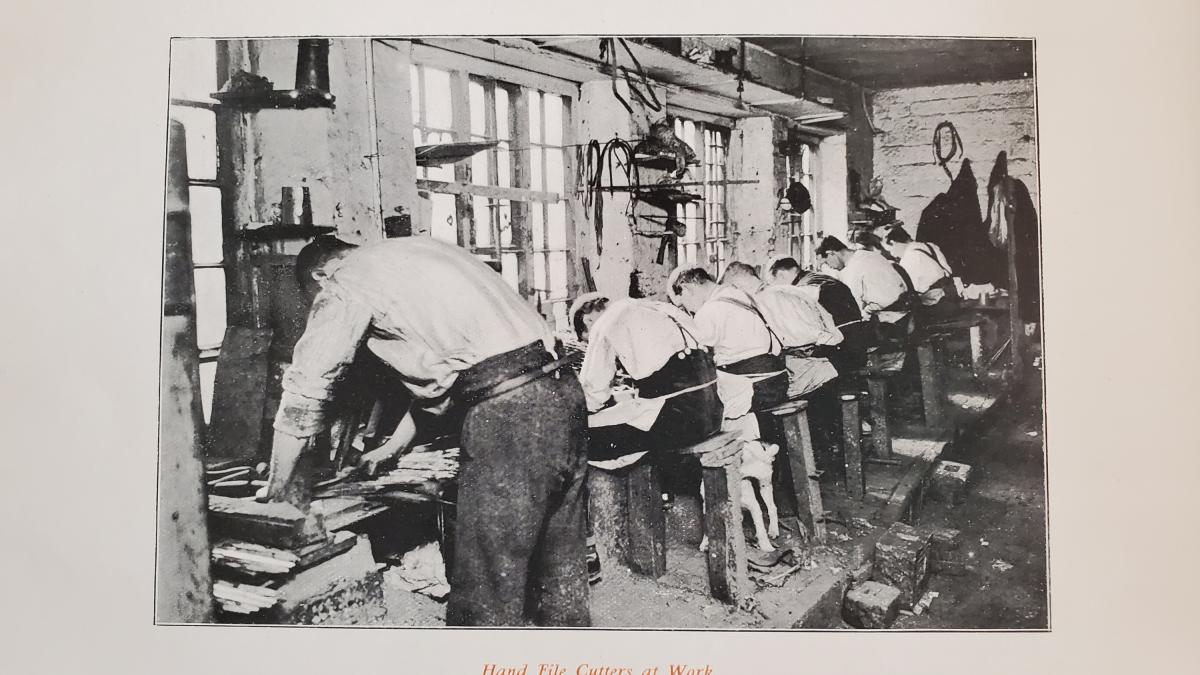 Men hand cutting file teeth. From the book