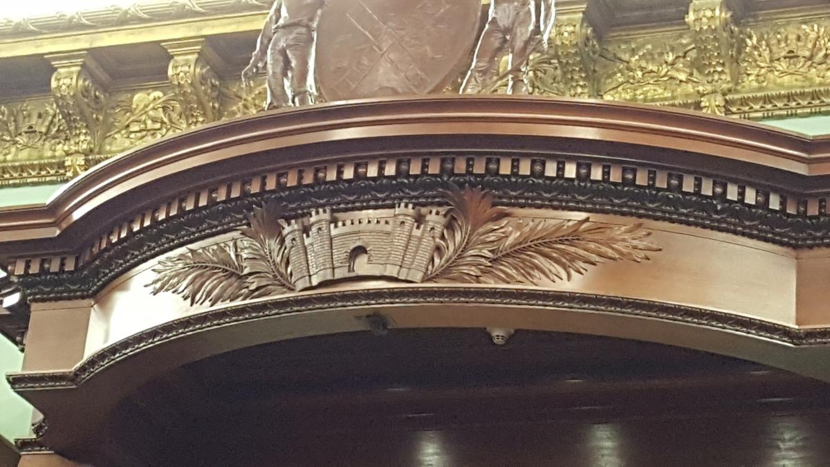 Carved detail above the podium