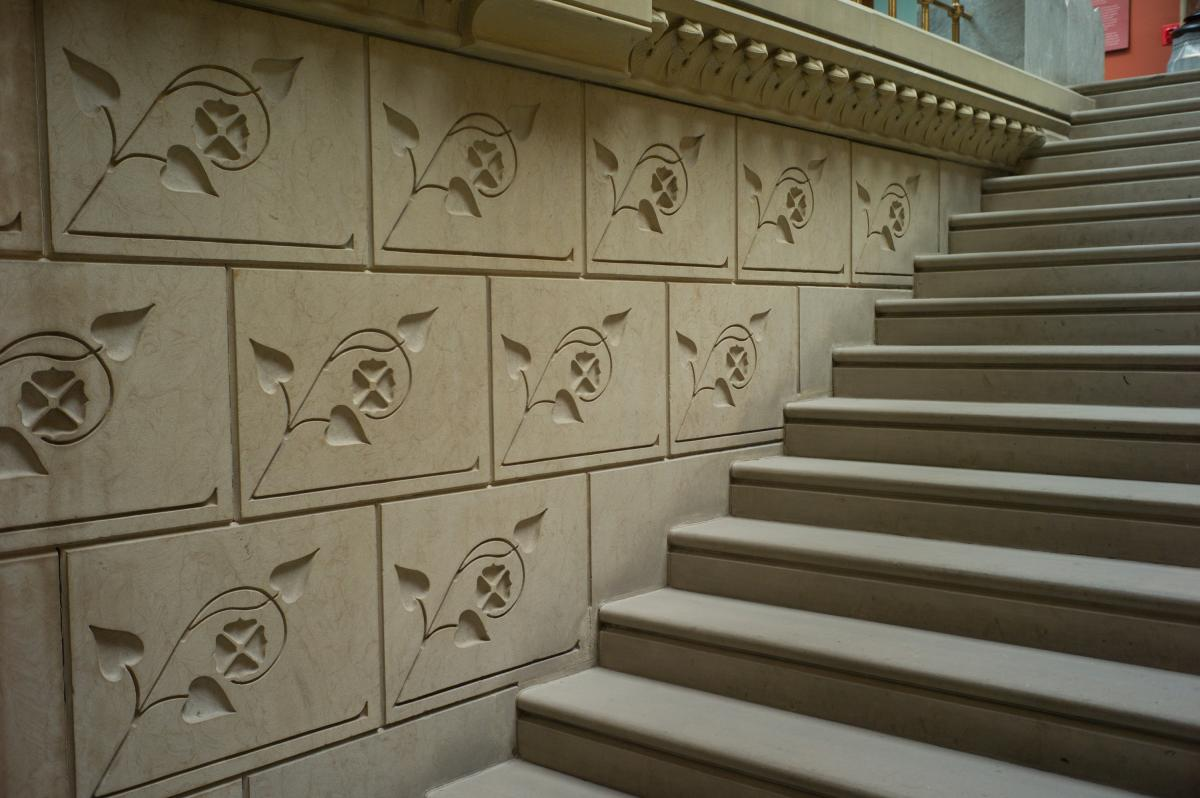 This repetitive pattern carved in stone adds interest to the staircase.