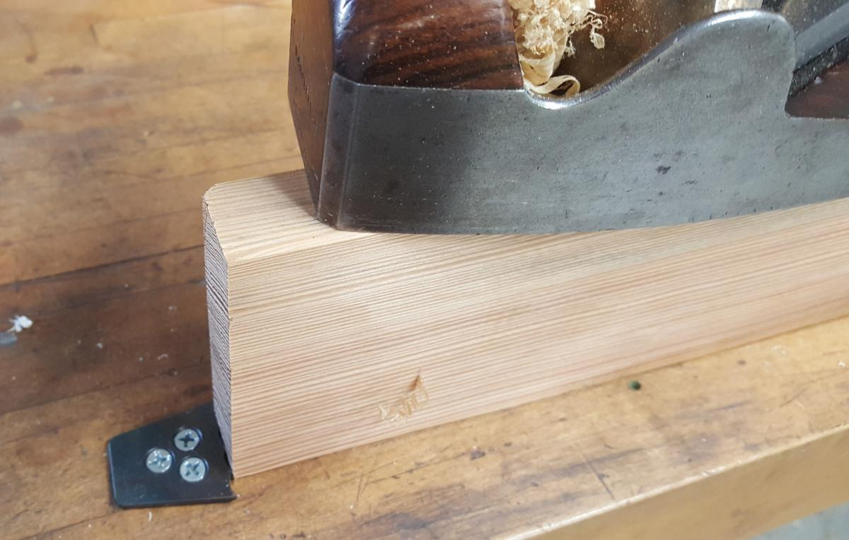 On my bench the planing stop is attached to a square peg that fits into existing bench dog holes.
