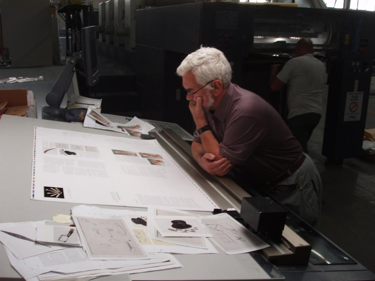 David Russell checking running sheets of his book on press at the printer's in Italy