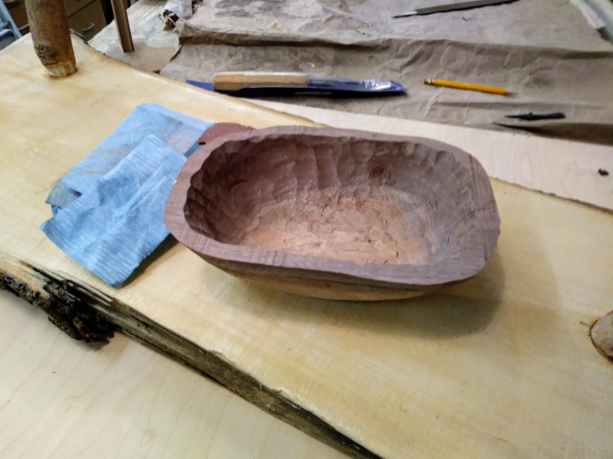 The walnut bowl in the pictures above was created by one of my students. Ideally, more time should have been spent in refining both the exterior and the interior of the bowl before removing the clamping block from the top of the bowl to the keel, and then before sawing off the keel. As a result of time constraints this bowl will look more rustic, showing gouge marks in the inside.