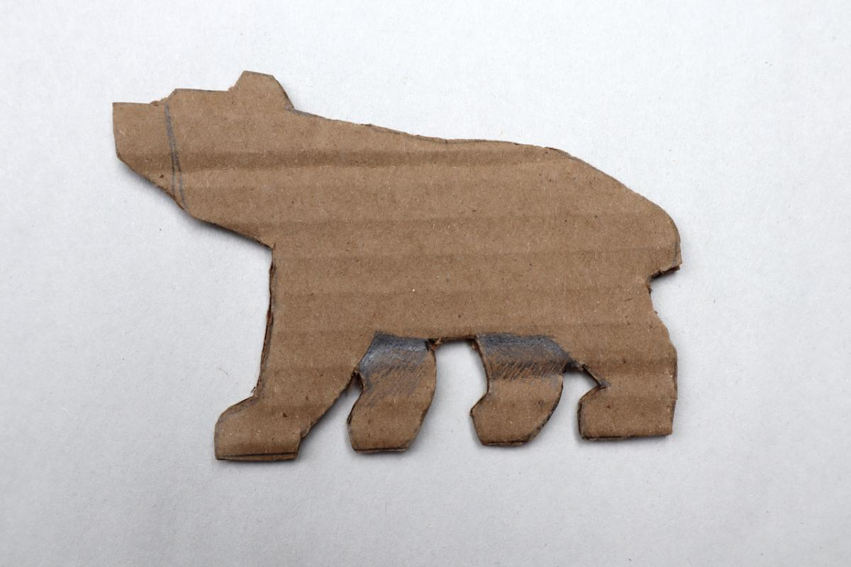 In option two the legs on the right side are closer together. On the left side of the bear the two legs are splayed (the front one point forward and the back one backward