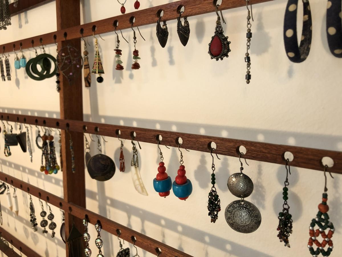Thin horizontal pieces with holes drilled to hold the earrings