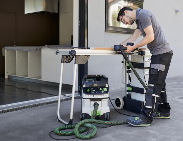 Festool MW 1000 Mobile MFT Work Shop - The MW 1000 table in use. Tools and vacuum not included. And the stock picture is way too clean to be an actual jobsite.