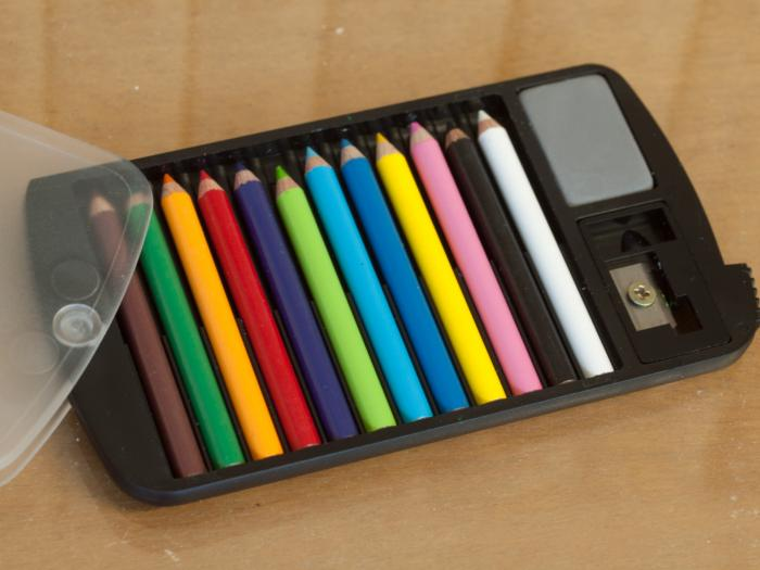 Portable Mini-Pencil Set with Sharpener and Eraser - 12 colors, 1 sharpener, 1 eraser, in a folding fitted case.