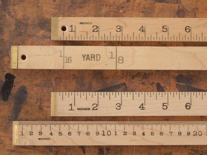 Brass Bound Yard and Meter Sticks - Yard Stick (TOP) has Inches and 1/8ths of a yard. Meter Stick (BELOW) has MM and Inches.